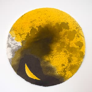 Yellow circular planet-sized ball