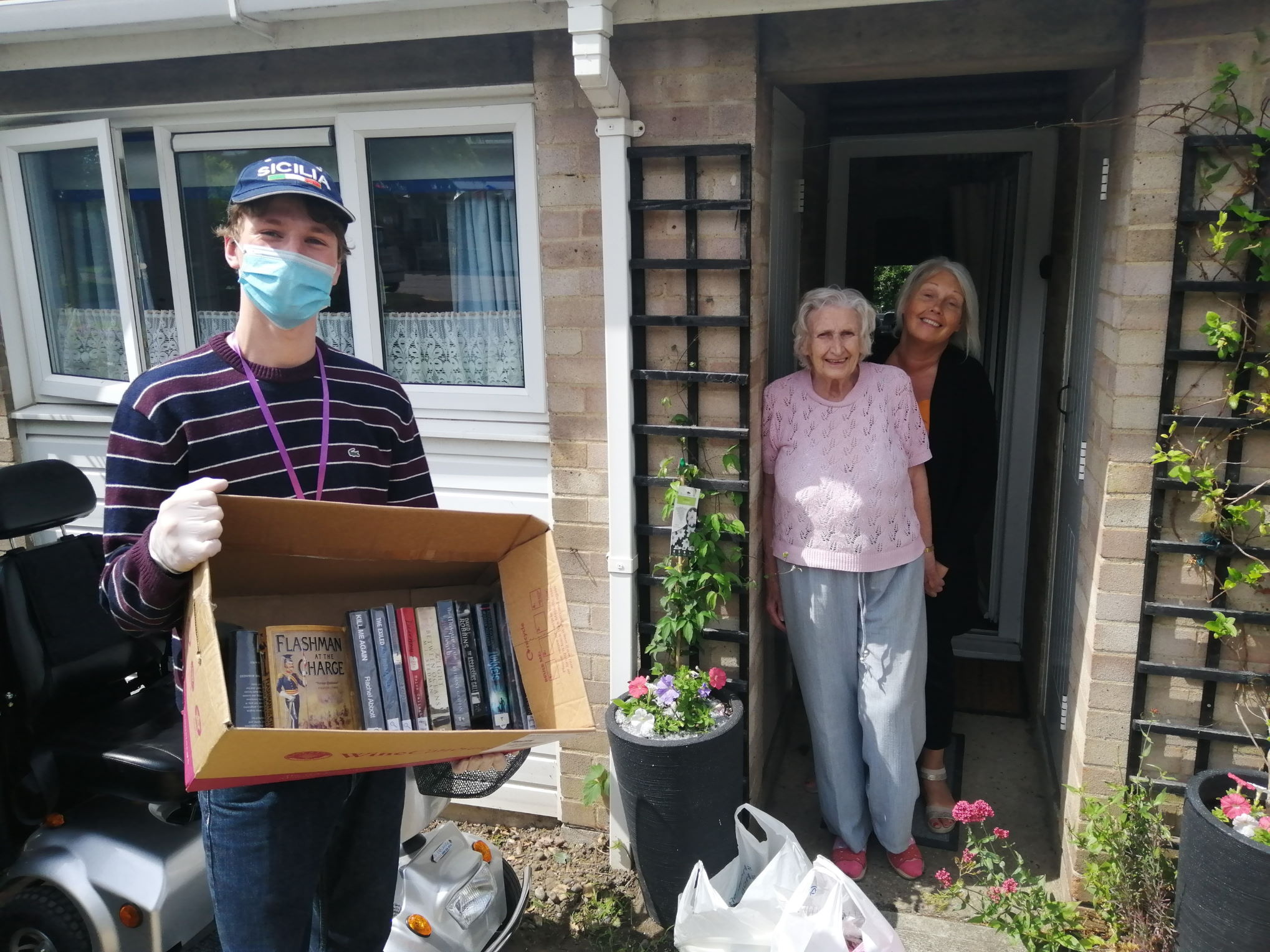 Volunteers delivering donated books in Halesworth