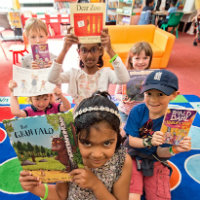 Children holding up books that are popular with Suffolk Libraries readers